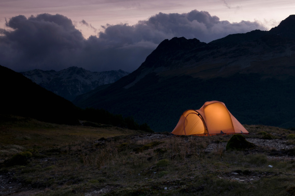 Cultura: Lit up tent at the mountains