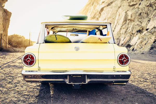 Premium photographer example: Vintage station wagon at beach