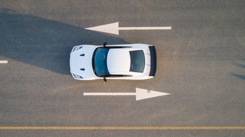 car, arrows. reversal, uncertain, direction, choice, street, road, bird's eye view, aerial image, drone photography, royalty free