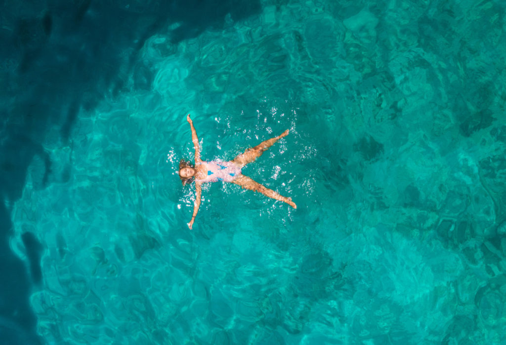 woman, sea, relaxing, sun, holiday, vacation, Model Release, bird's eye view, aerial image, drone photography, royalty free