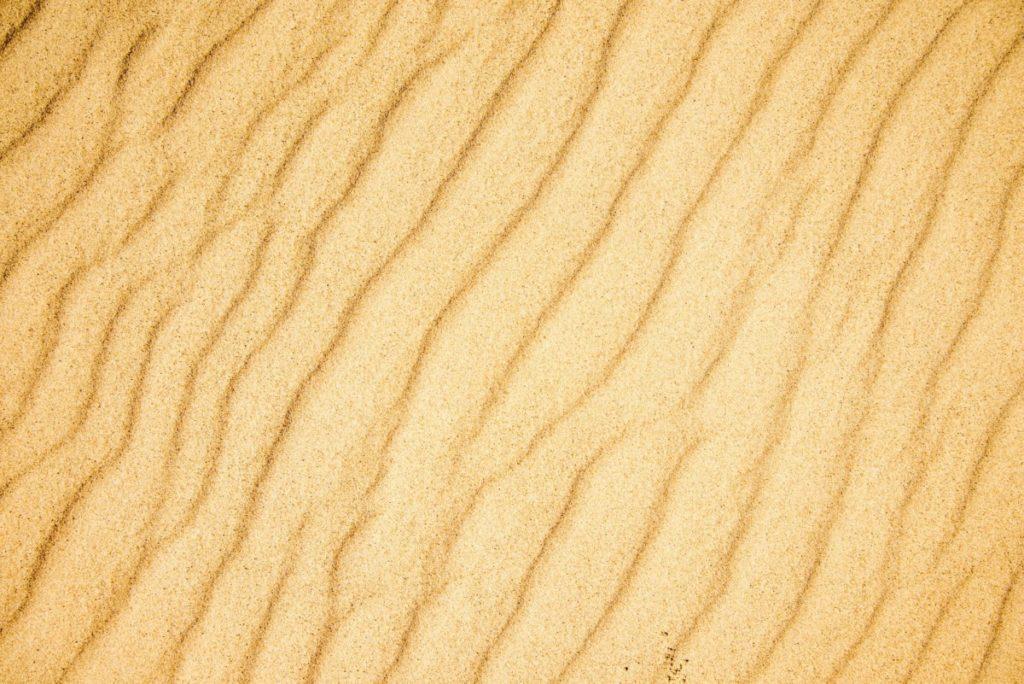 Sand wellenoberfläche textur material sand braun lizenzfrei bild foto